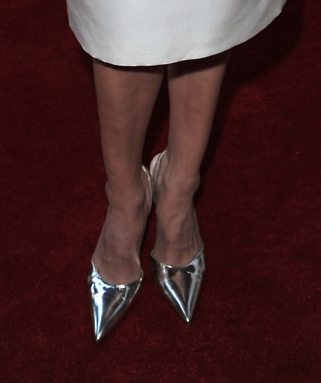Hilary Swank added major shine to her white ensemble via silver metallic pointy pumps at the Montblanc and UNICEF event.