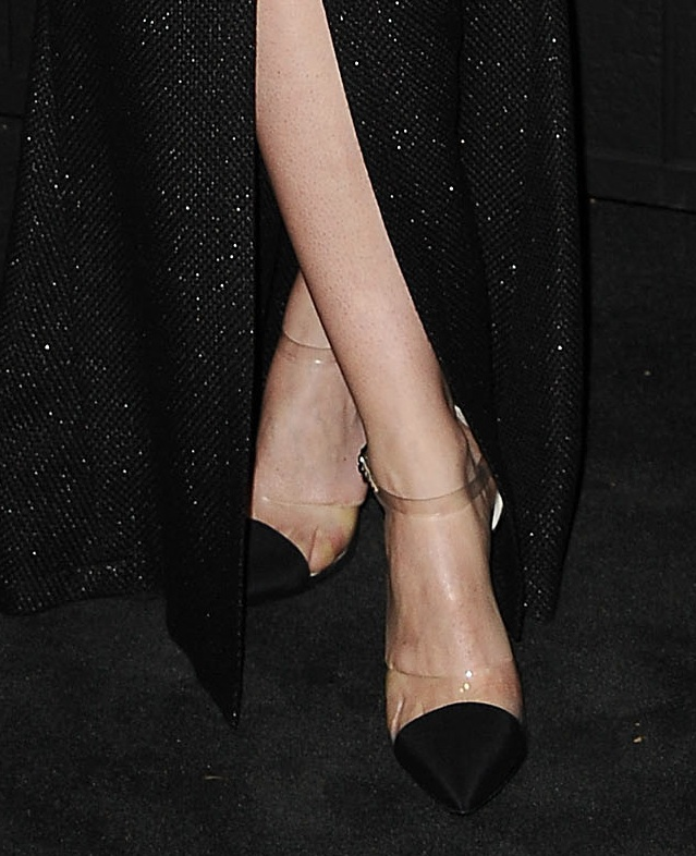 At the Chanel dinner, Felicity Jones paired a black-and-white Chanel dress with PVC Chanel pumps.
