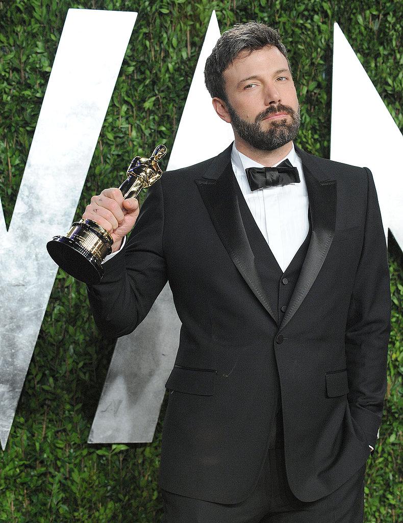 Ben Affleck raised his Oscar on the way into Vanity Fair 's Oscar party.