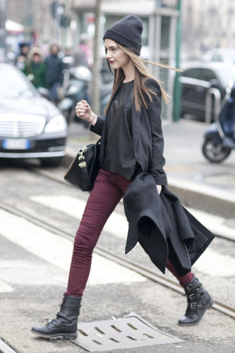 The cool-girl getup at its best — burgundy, biker boots, and a little leather, all topped off with a beanie.