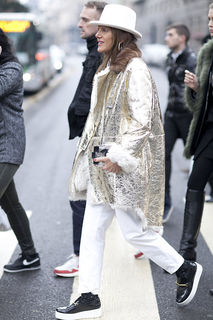 Anna Dello Russo layered up her white pants with a statement-making gold metallic jacket.