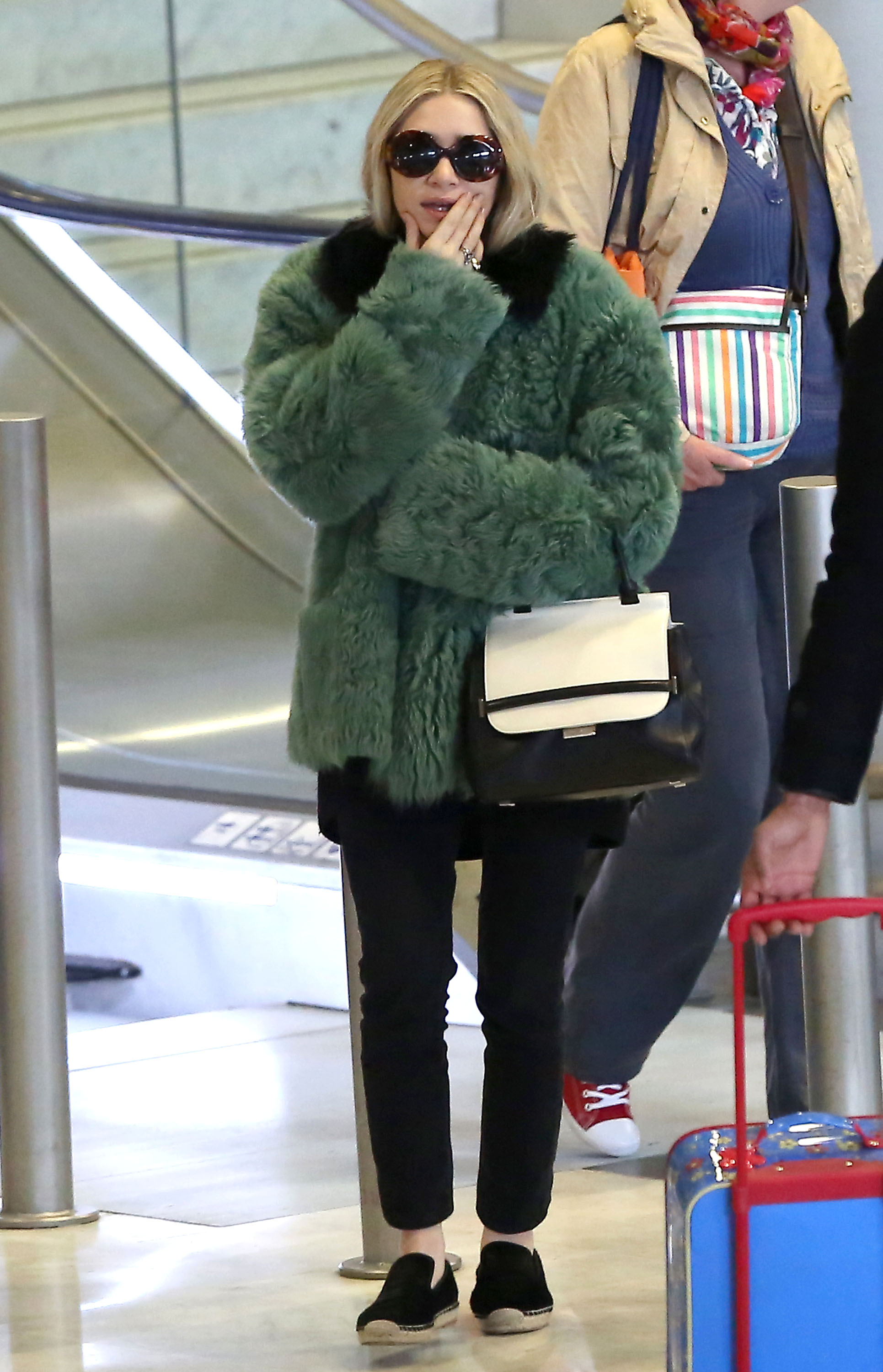 Ashley Olsen Takes a Fashionable Flight to the City of Light
