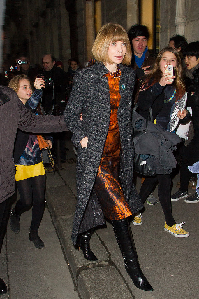 Anna Wintour gave a lesson in sophisticated styling, pairing a landscape-print dress and black leather boots with a long tweed coat on her way to the Rochas show during PFW.