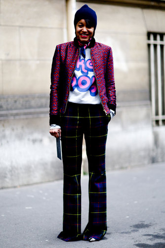 We love the punchy play between her plaid pants, printed jacket, and sporty sweatshirt.