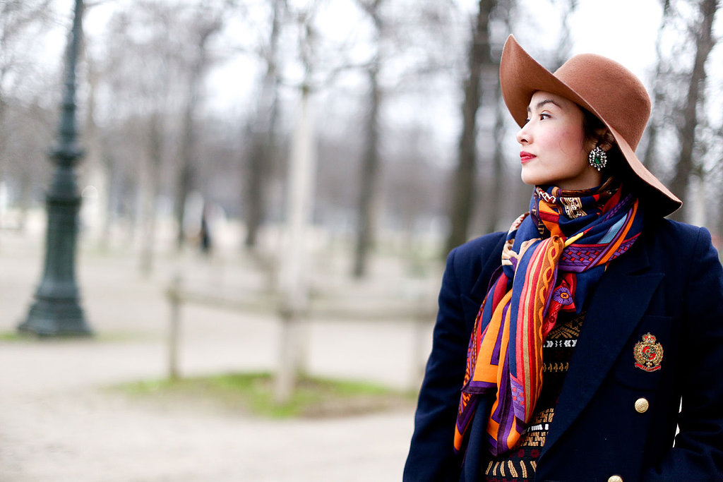 A floppy hat look isn't quite complete with out a dose of red lip color.