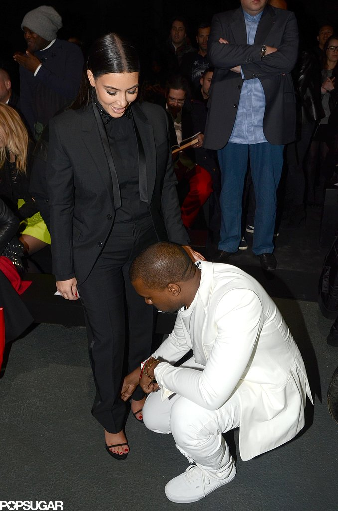 Kanye West helped Kim Kardashian with her shoe.