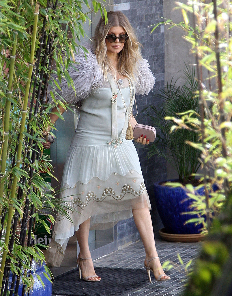 Fergie wore feathers to her sister's bridal shower.
