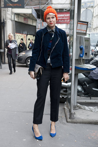 Elisa Nalin worked the sporty-prep angle in a bright beanie, smart trousers, and punchy footwear.
