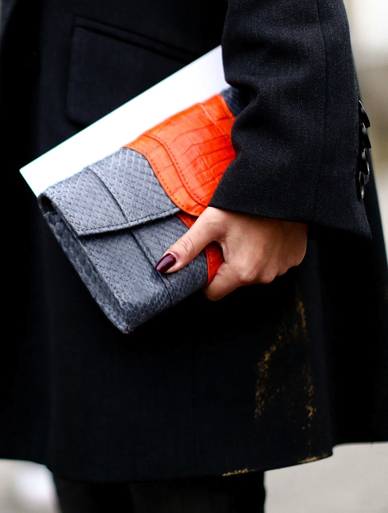 An exotic colorblocked clutch added a vibrant splash to dark accompaniments.