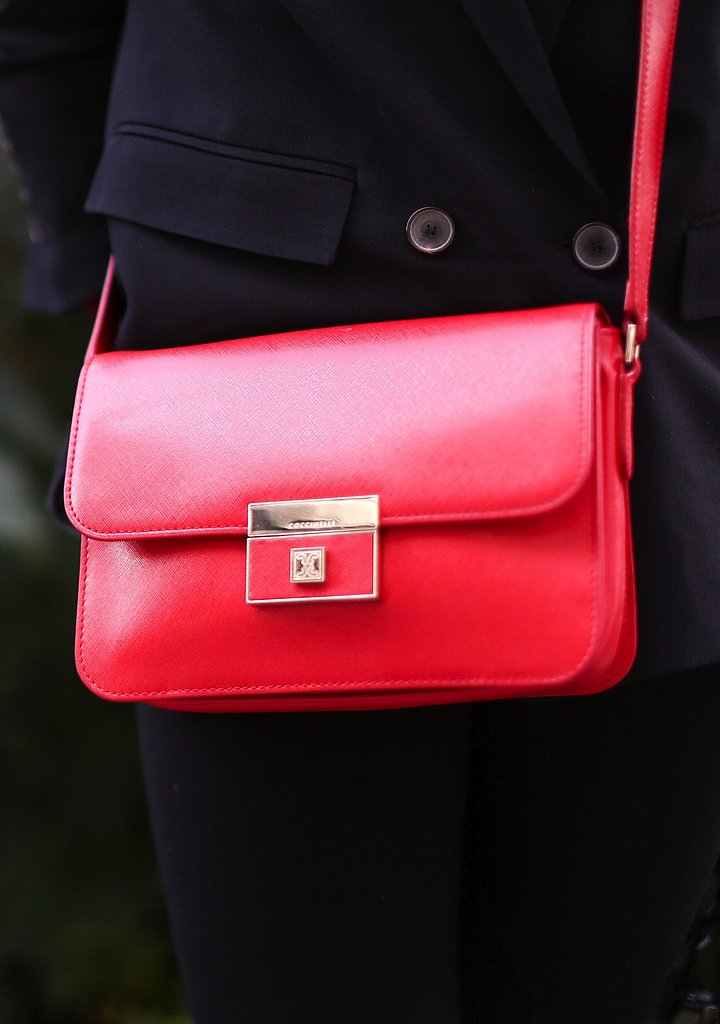We love the ladylike silhouette and bright red hue of this classic shoulder bag.