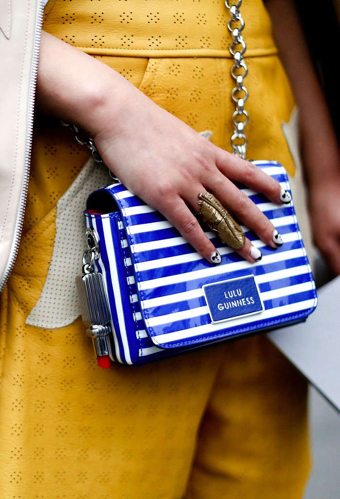 A striped Lulu Guinness bag popped against an equally stunning saffron-yellow backdrop.