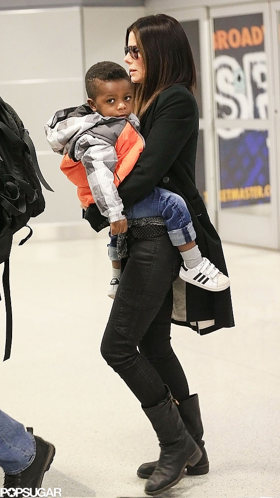 Sandra Bullock landed in NYC with her son.