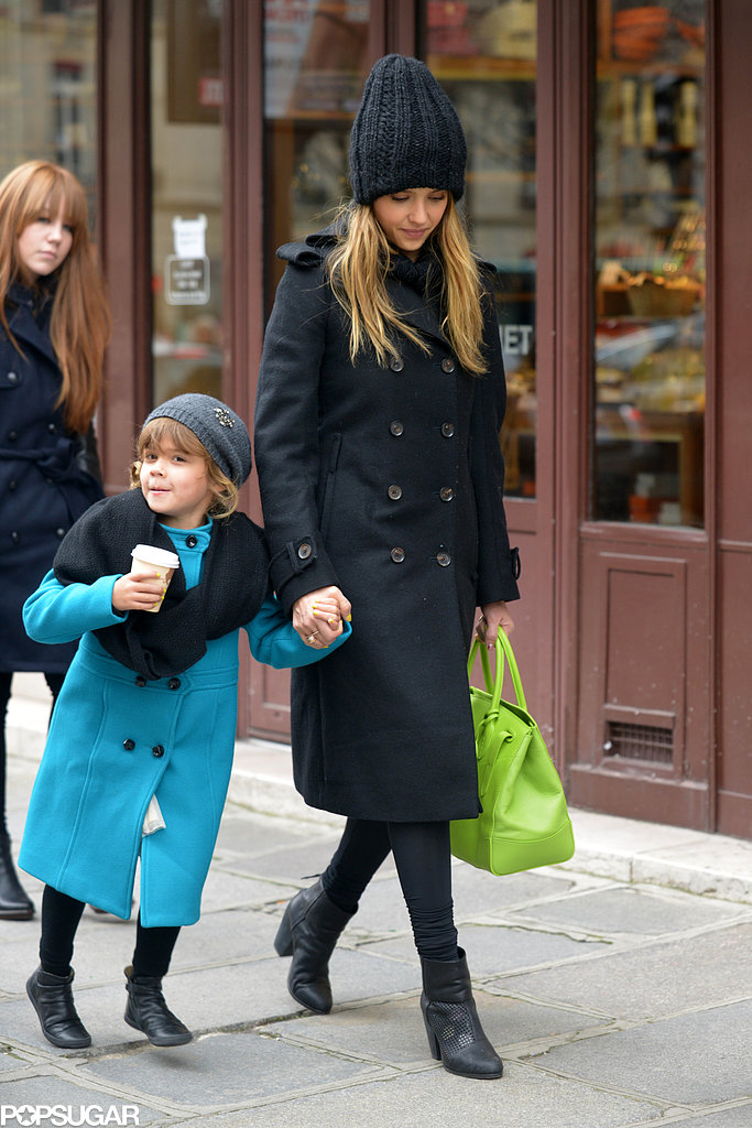 While vacationing in the City of Light, Jessica jazzed up her black-on-black combo — double-breasted coat and knit beanie — with a neon green tote and a pop of polka dots seen through her perforated Rag & Bone ankle boots.