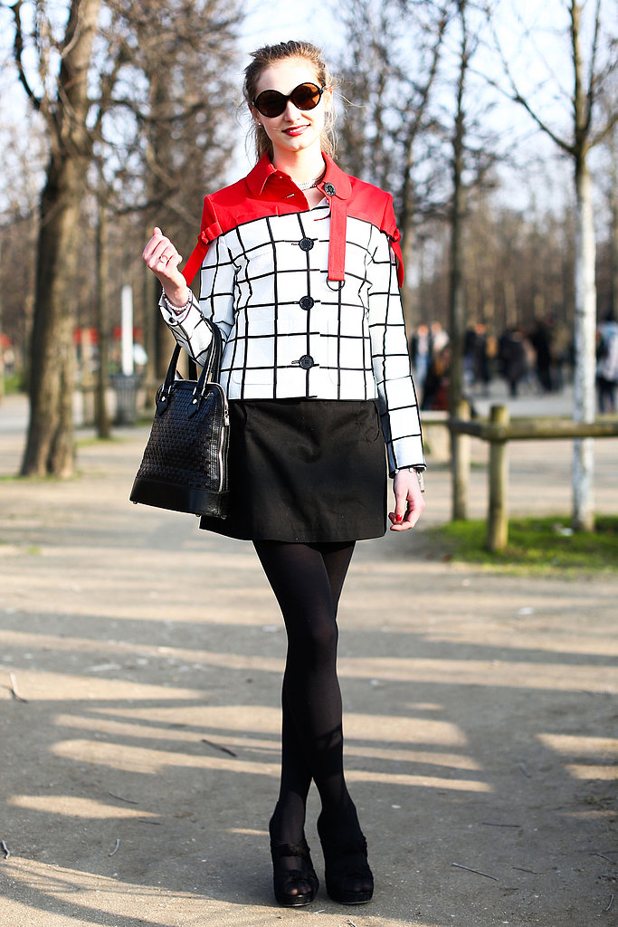 A mod moment, from the windowpane-print jacket to her top-handled satchel.