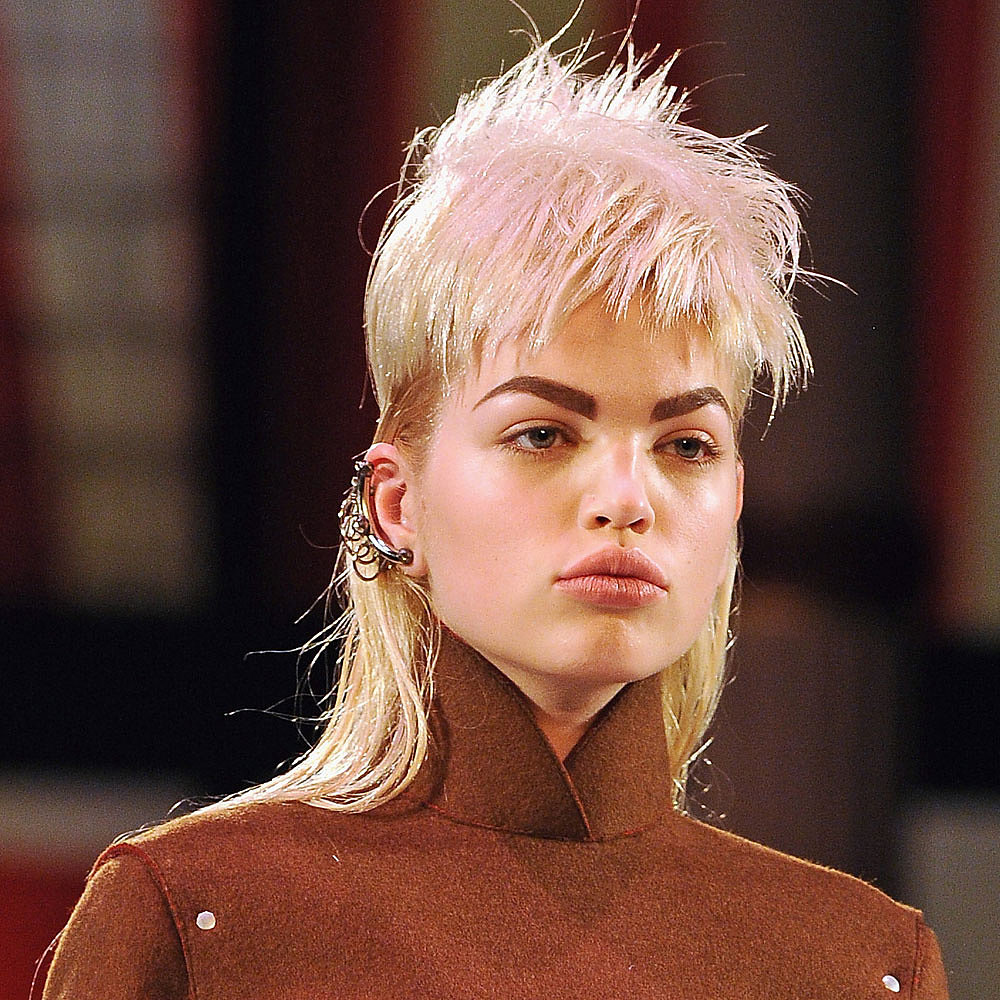 "Guido and his team cut 34 wigs individually for each model to work with her face shape on-site at the show, explaining that he wanted to ""make them look as good as possible so it's like a haircut on each girl."" Unlike other shows he's worked on this season like Marc Jacobs, these were inexpensive hairpieces as opposed to lace-front wigs."
