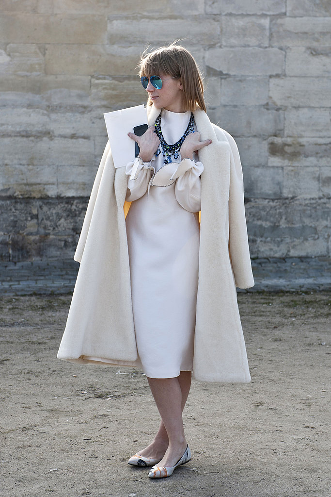 Statement jewels and serene blue mirrored shades popped against all white.