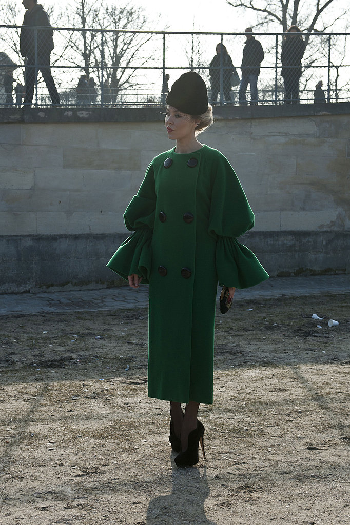 Sculpted bell sleeves and a brilliant emerald green added to the drama of Ulyana Sergeenko's look.
