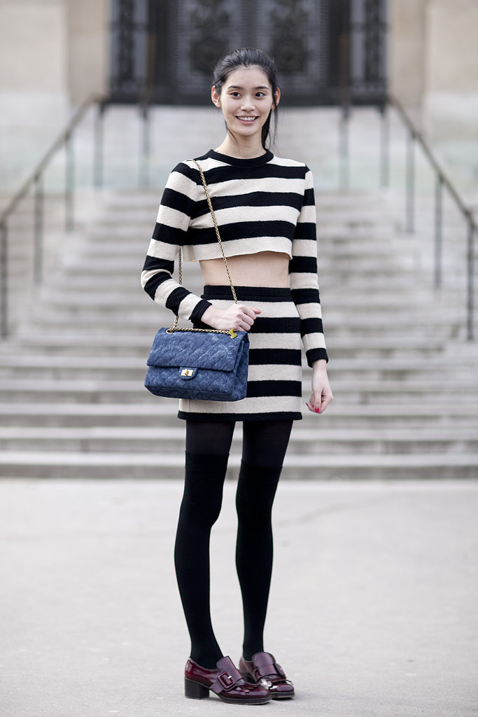 This showgoer emboldened tomboy footwear with a crop top and skirt set in notice-me stripes.