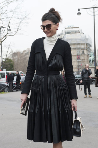 Giovanna Battaglia put her own spin on the classics in a pleated black coat and creamy white turtleneck.