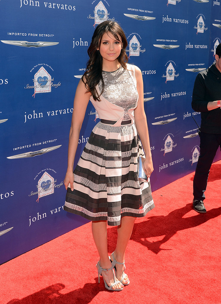 Nina Dobrev showed off a ladylike Elie Saab fit-and-flare dress and Jimmy Choo sandals for the John Varvatos Stuart House benefit event in LA.