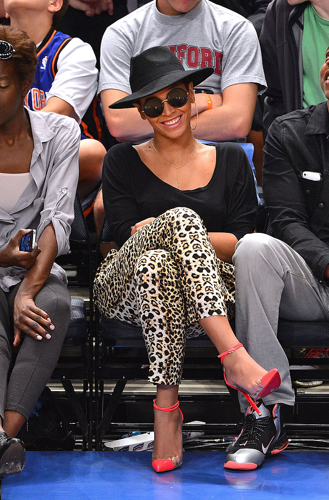 Beyoncé showed off fierce sideline style in April 2012, wearing a pair of leopard-print pants, hot-pink Christian Louboutins, and a wide-brimmed hat.
