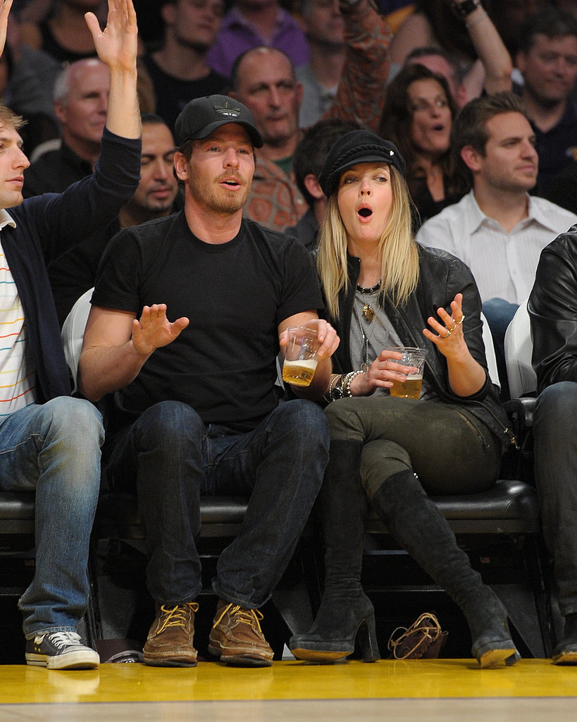 The only thing cooler than Drew Barrymore's military-inspired courtside look: the fact that she's so into the game! Drew watched the Lakers play the LA Clippers with husband Will Kopelman in March 2011 in a vintage tee and laid-back olive-hued pants.