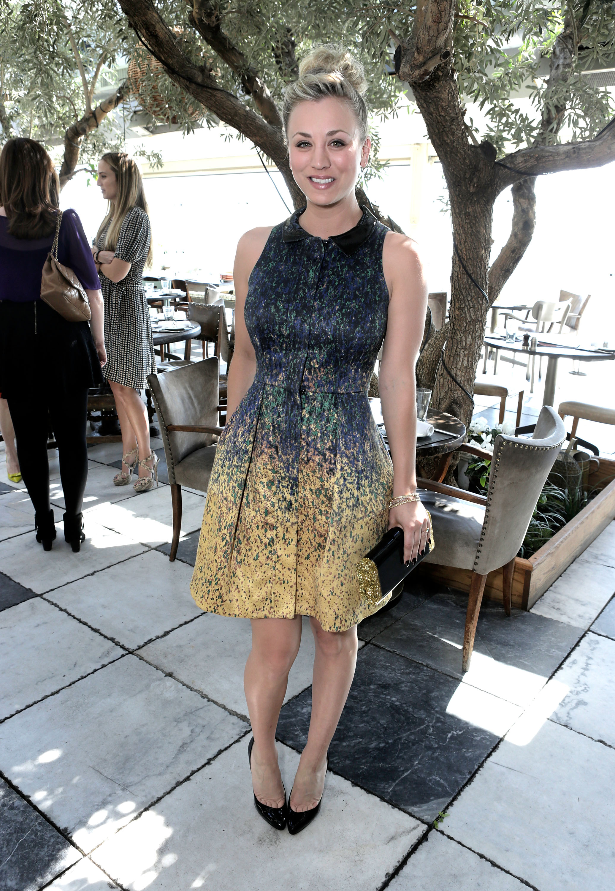 Kaley Cuoco also went with a printed McGinn dress for the daytime affair, accessorized with black Jimmy Choo pumps and a black-and-gold clutch.