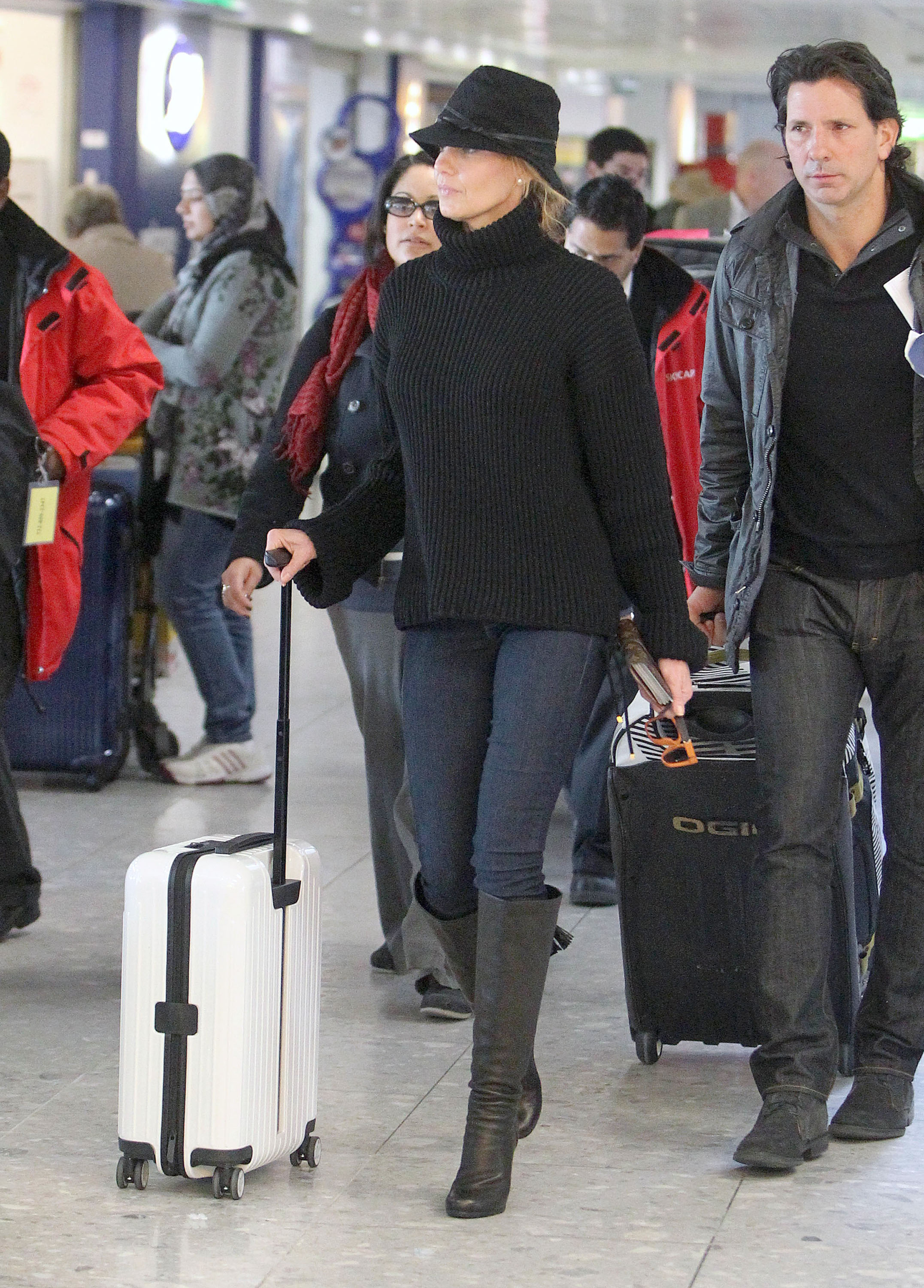 Faith Hill wore a black hat and sweater.