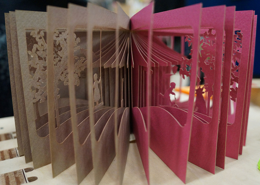 Laser-printed pages crafted at FabCafe.