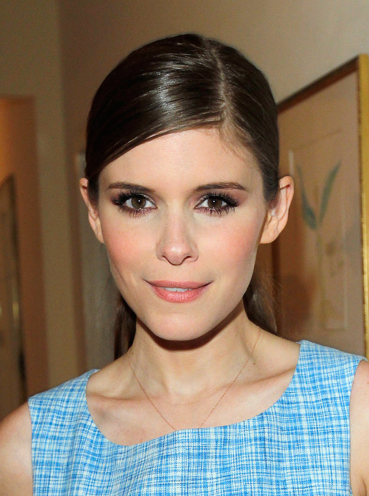 Kate Mara added some glow to her complexion with a matching peach shade on her lips and cheeks. Try using a cream blush on your lips and cheeks to get a similarly flattering look.