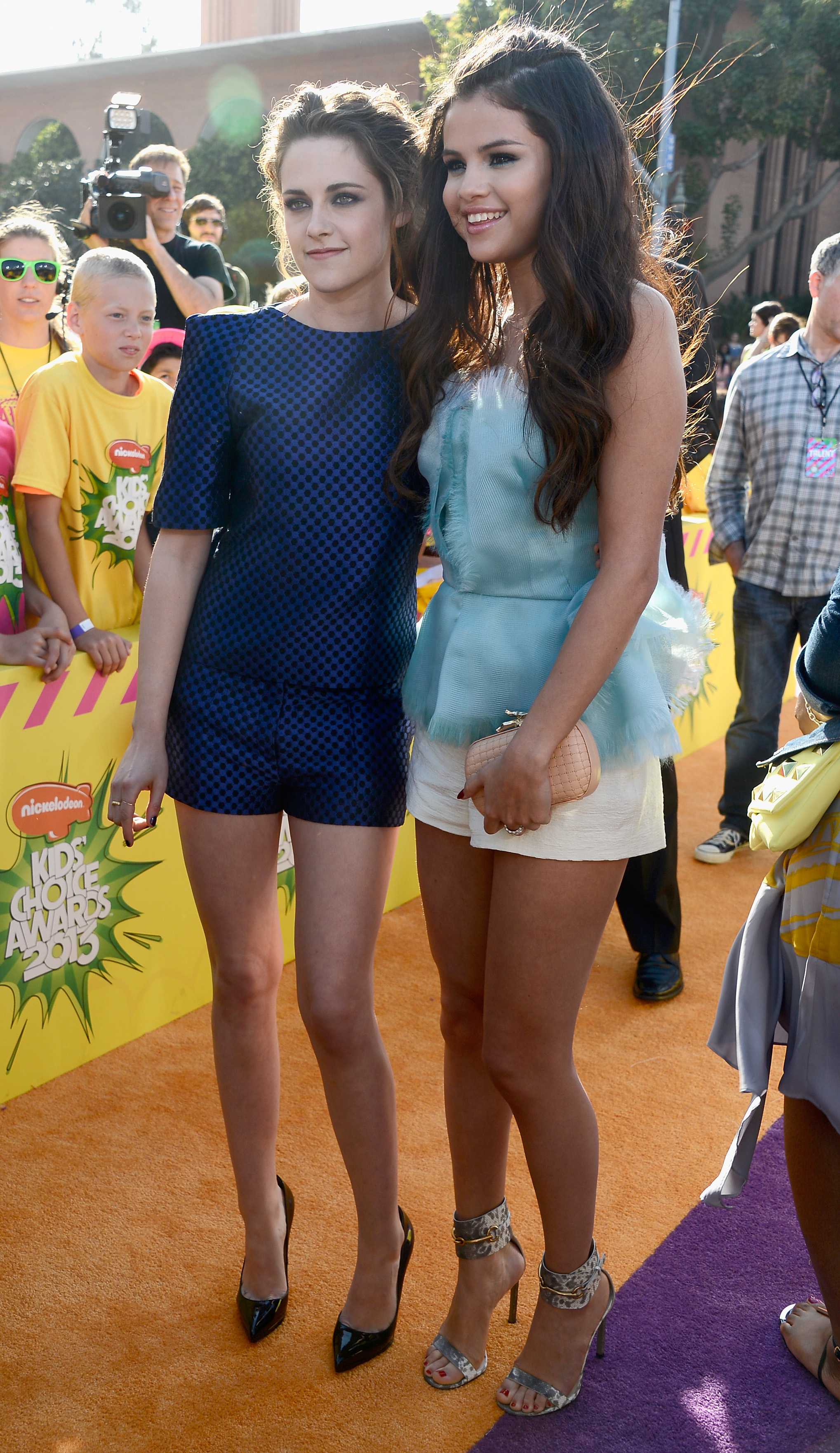Selena Gomez linked up with an Osman-clad Kristen Stewart on the orange carpet.