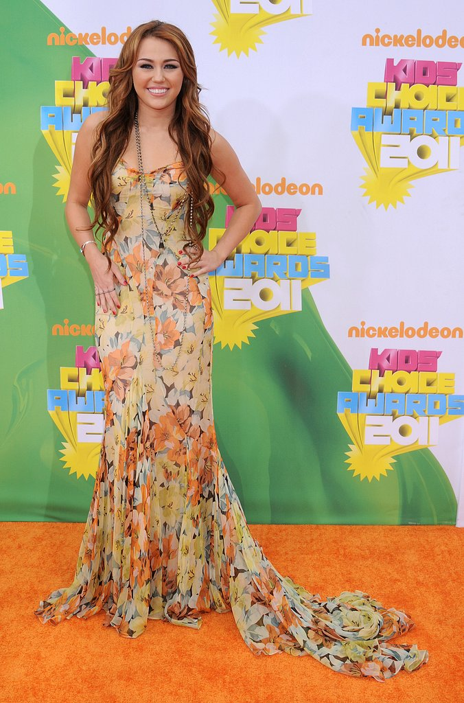 Miley Cyrus stepped out in 2011 in a feminine, floor-skimming Dolce & Gabbana gown.