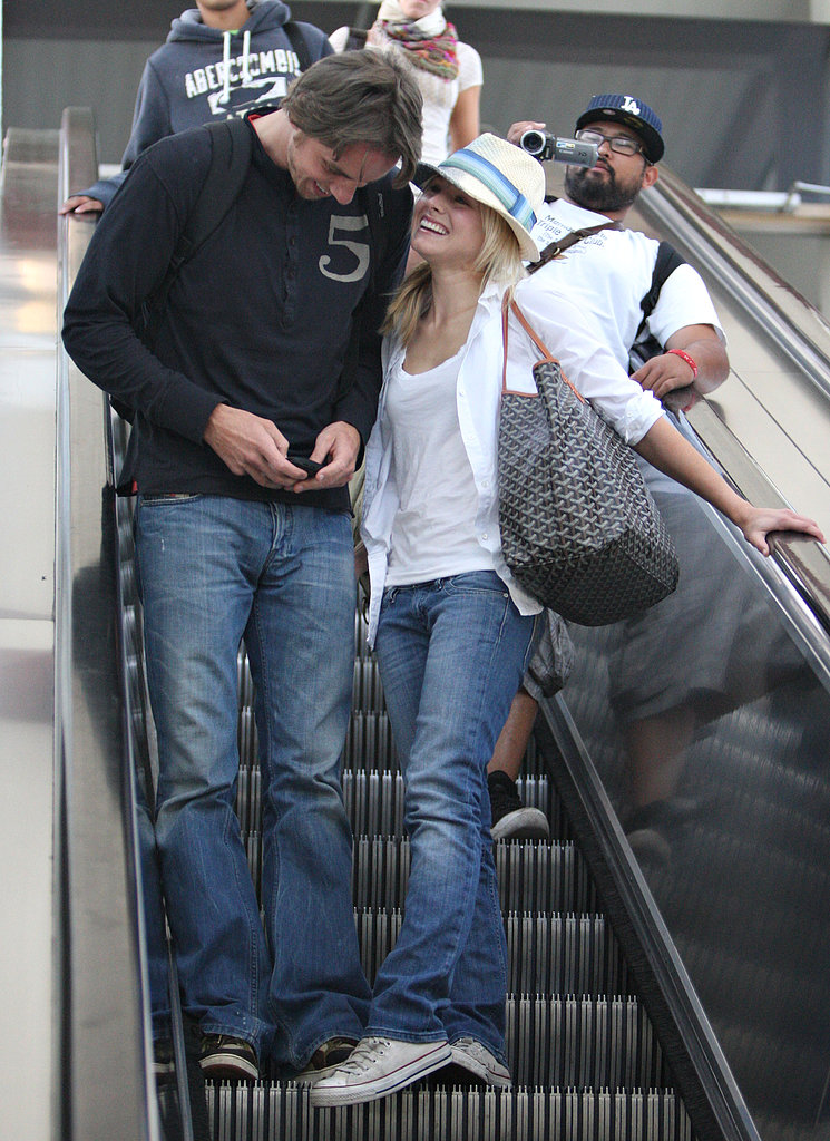 Kristen grinned from ear to ear while arriving at LAX with Dax in July 2008.