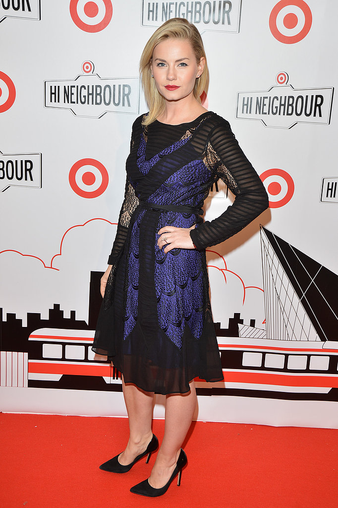 Elisha Cuthbert wore a glamorous black and blue frock.