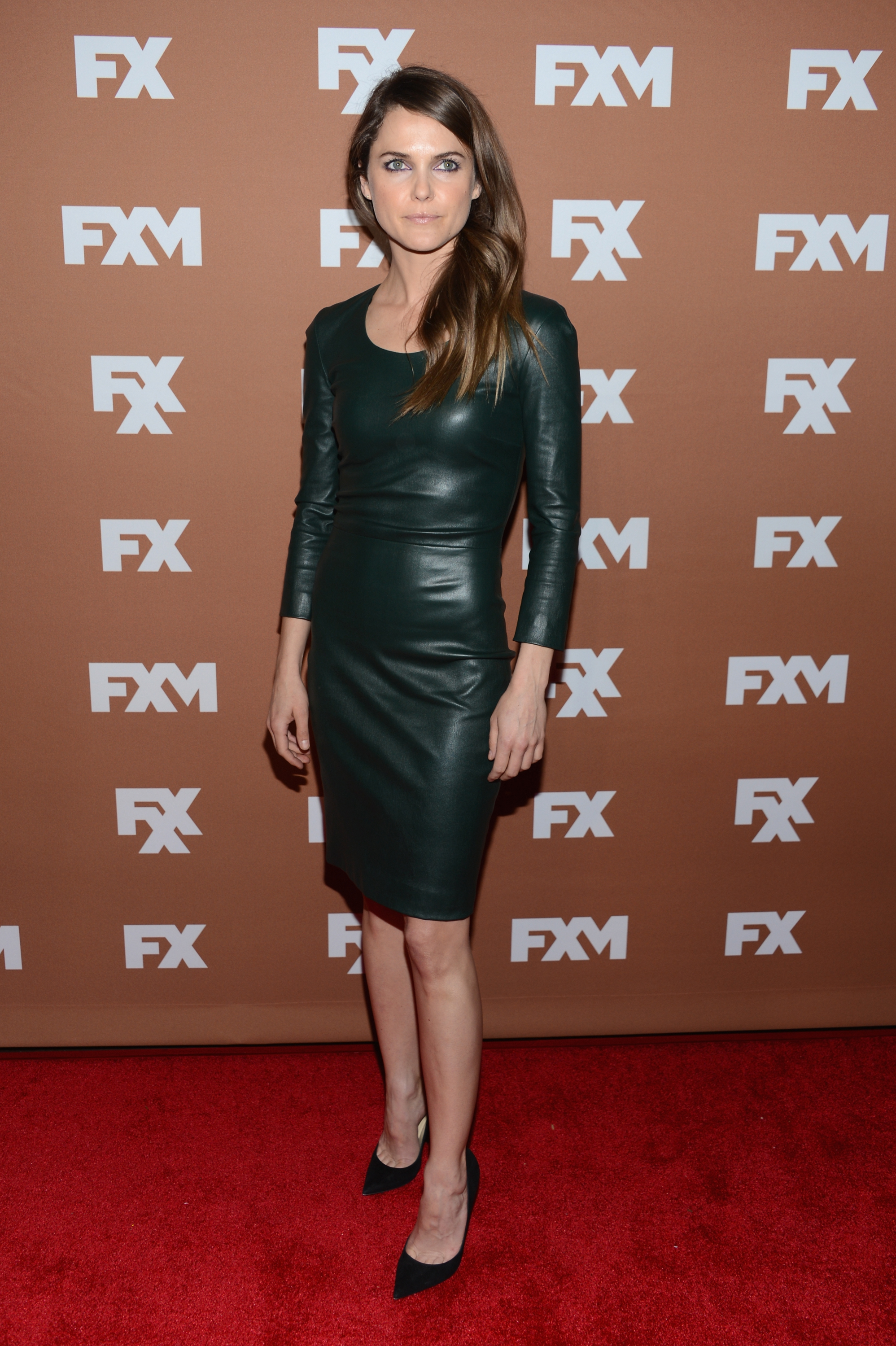 Keri Russell made a showstopping arrival at an FX event in NYC, stepping out in a body-conscious leather sheath dress.