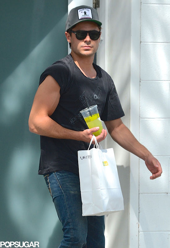 Zac Efron showed off his muscles in a t-shirt on set in LA.