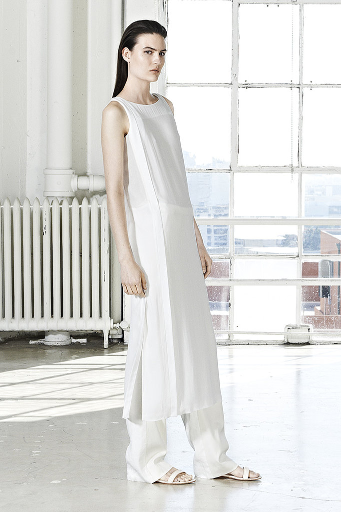 We can't get enough of dresses over pants right now — especially this white-on-white pairing.