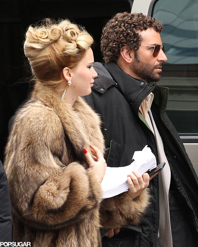 Jennifer Lawrence had her hair in an updo to hit the Boston set with curly-haired Bradley Cooper.