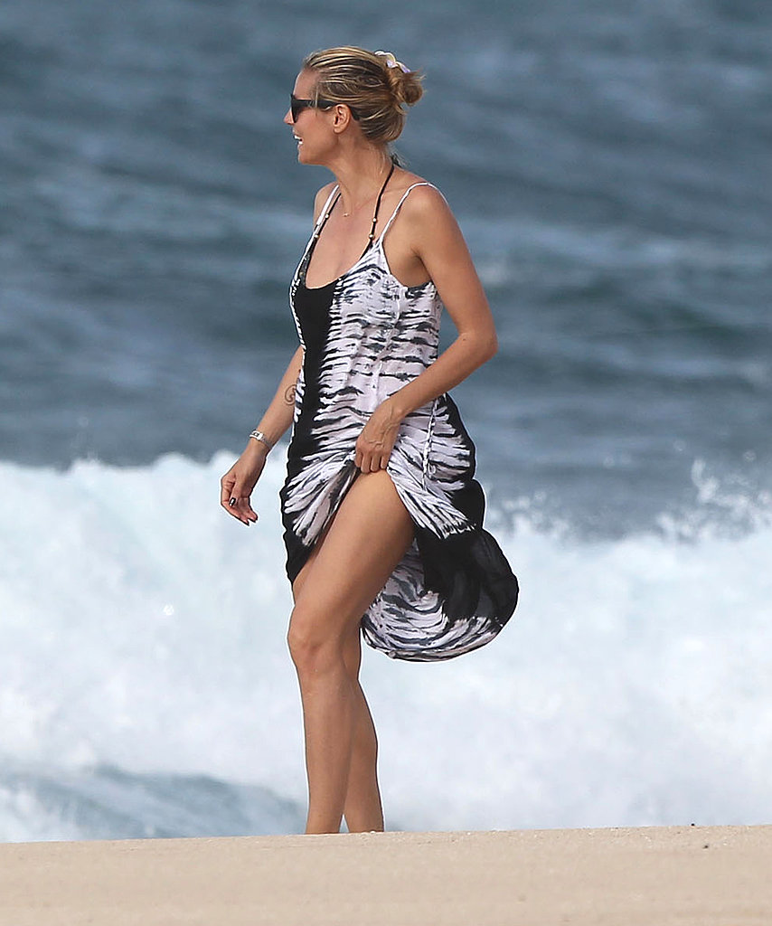 Heidi Klum wore a tie-dyed cover-up on the beach.