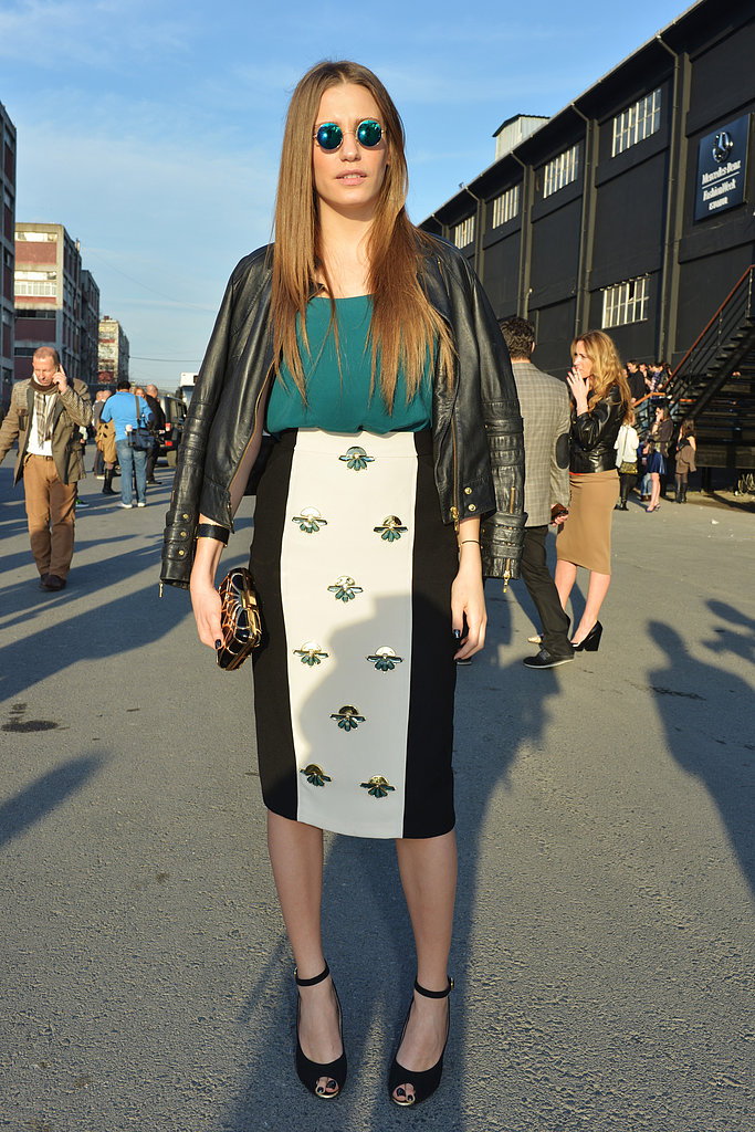 The downtown take on the pencil skirt, with a leather jacket thrown nonchalantly over her shoulders.