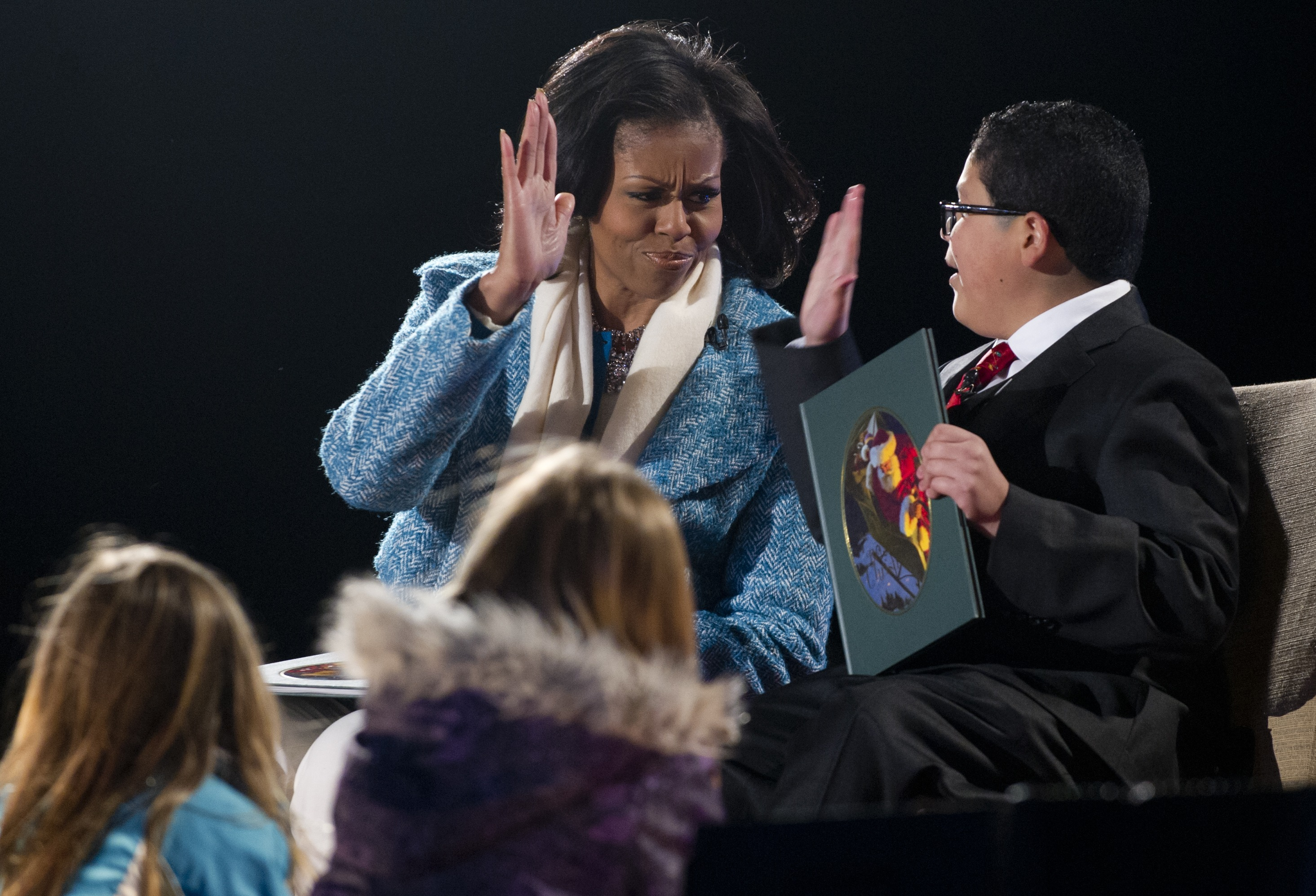 Modern Family star Rico Rodriguez received a celebratory clap from Michelle Obama during a Christmas 2012 event in Washington DC.