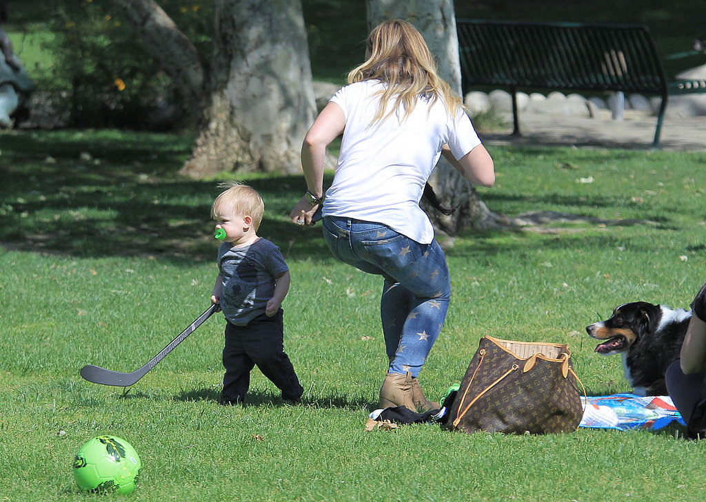 Luca Comrie played with a hockey stick at the park with his mom, Hilary Duff.