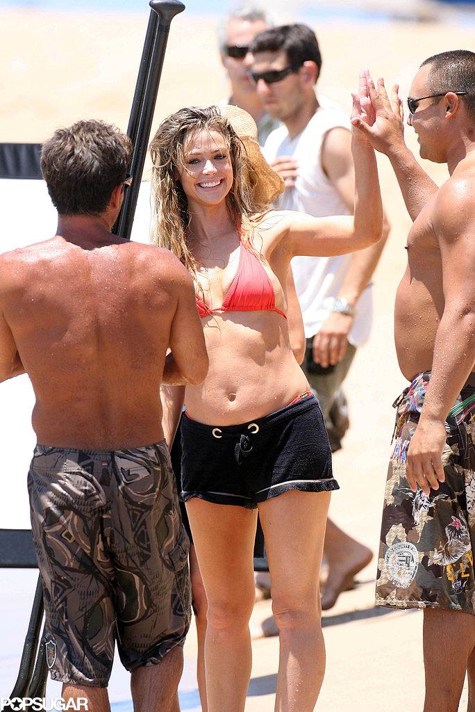 In April 2008, Denise Richards gave a male friend a high five during a beach trip in Maui.