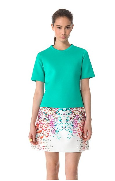 Neoprene gives this Josh Goot relaxed tee ($320) a sportier, surf-inspired flair that looks even cooler juxtaposed against sleek skirts.