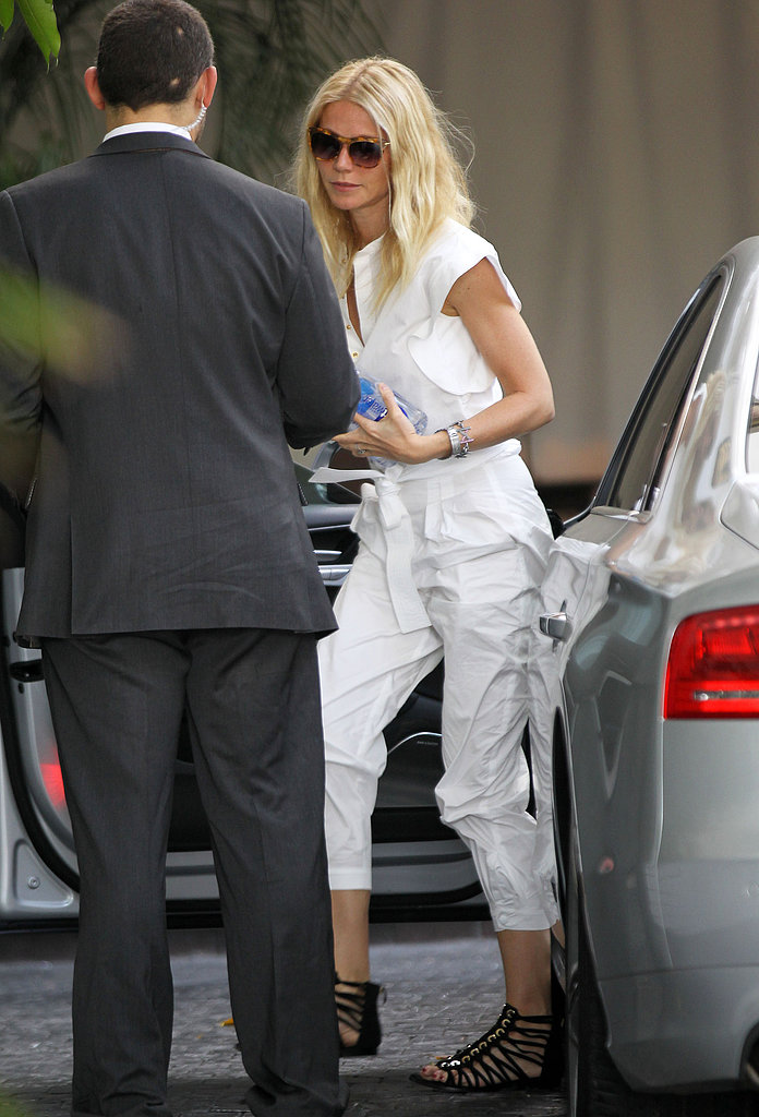 Gwyneth Paltrow donned a fresh white jumpsuit with black strappy flat sandals while arriving at LA's Chateau Marmont.