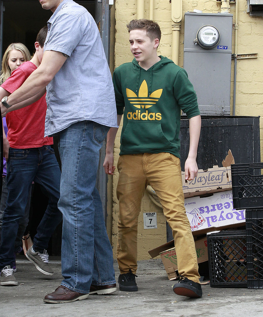 Brooklyn Beckham helped load his family into their car.