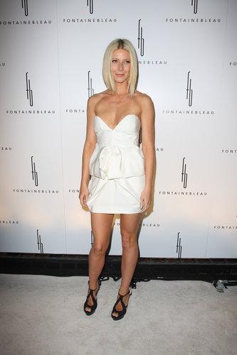 Gwyneth showcased her fit frame in a strapless Stella McCartney mini and Ferragamo cutouts in Miami.