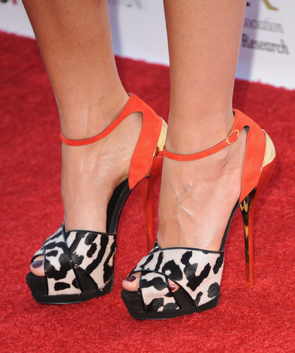 Distinguished detail: the wild leopard print and punchy orange ankle straps.