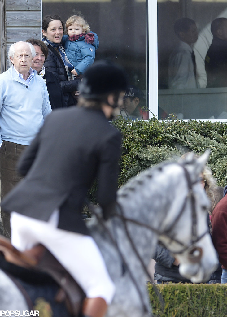 Marion Cotillard and Marcel Canet watched Guillaume Canet on his horse in France.