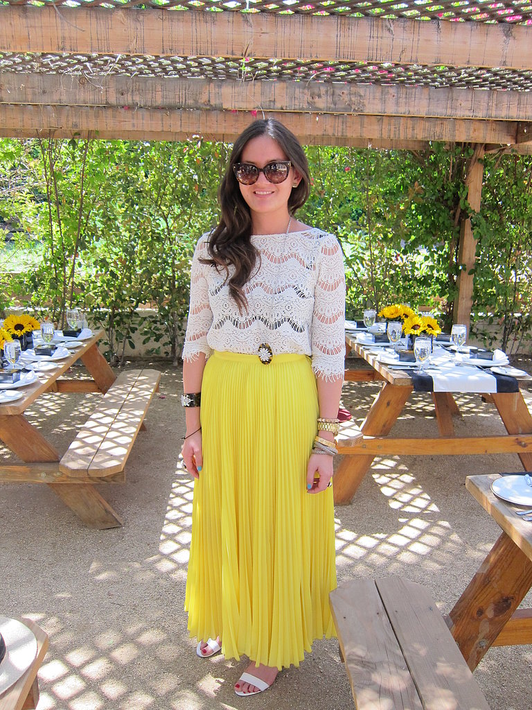 A bold yellow maxi dress added a pop of sunshine to a semisheer lace top. Source: Chi Diem Chau